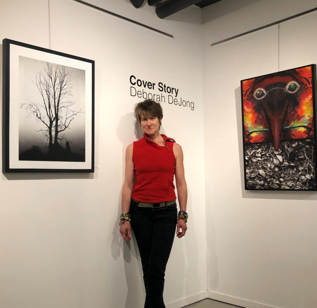 Photographic artist Deborah DeJong with her inaugural solo exhibition in Massy Books' Art Gallery